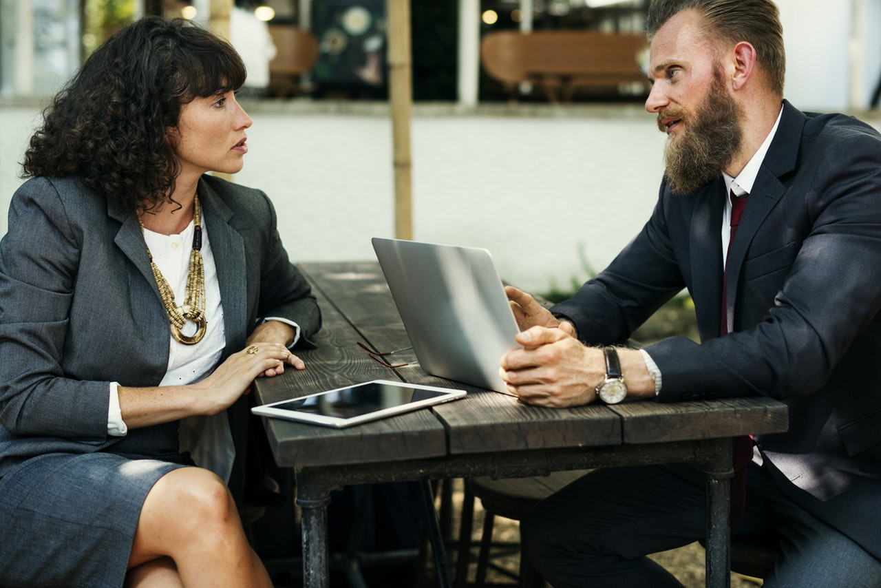 man woman office talk